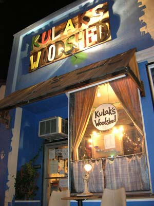 Photo of exterior of Kulak's Woodshed on Laurel Canyon Blvd in North Hollywood California at night with front window and overhead sign lit up brightly